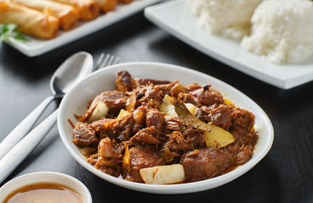 bowl of filipino pork adobo with rice