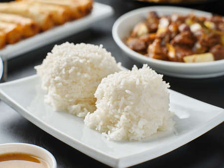 cooked white rice side dish as part of filipino meal Imagens