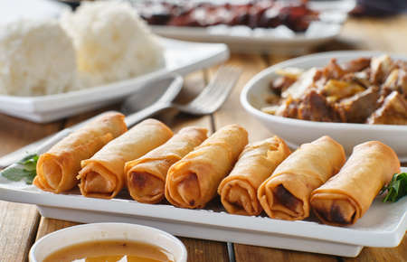 filipino fried lumpia on plate Imagens