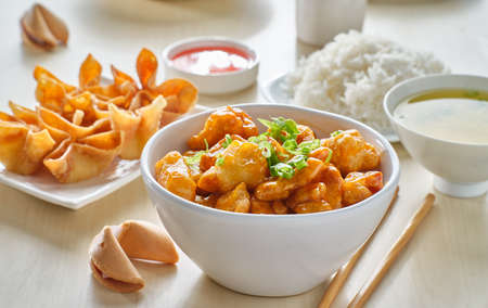 chinese food with orange chicken, crab rangoon and fortune cookie