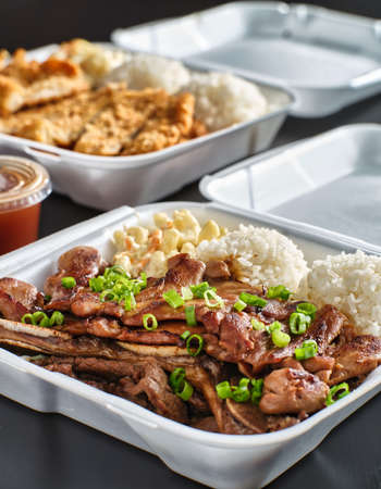 hawaiian bbq in take out container with mix of barbecue meats