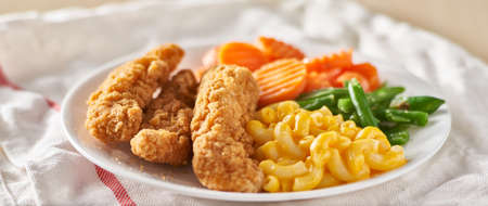 fried chicken tenders with macaroni and cheese plate