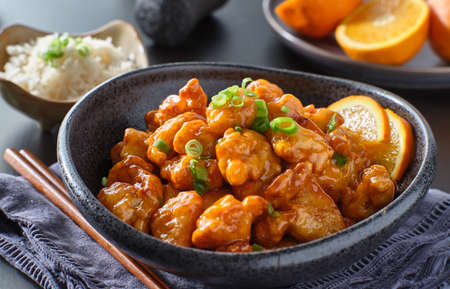 bowl of chinese orange chicken on table top