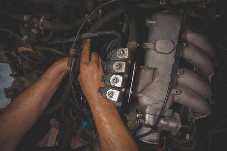 auto repair under the hood male hands dirty