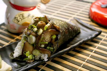 Japanese food: Shitake temaki sushi. Slice of Shitake mushroom in Temaki. Horizontal view. 写真素材
