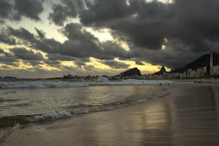 Rio de Janeiro, Brazil - March 29, 2019: Sunset View in Copacabana Beach with Mountains in Horizon and Tall Hotel Building, Rio de Janeiro, Brazil Redakční