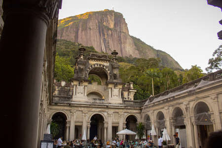 Rio de Janeiro, Brazil - August 17, 2019: Weathered colonial architecture of the public Parque Lage, built in the 1920s, reflecting the jungle of the surrounding Tijuca National Park.