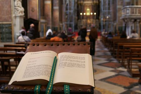 payer: Open payer book waiting for a priest