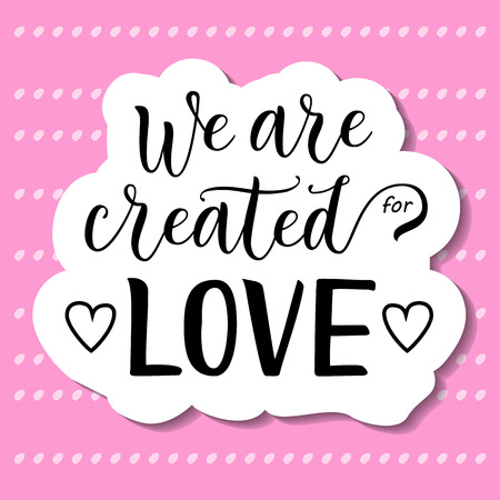 Modern calligraphy lettering of We are created for love in black with hearts and white outline on pink background decorated for decoration, poster, banner, valentine, valentines day, sticker, postcard