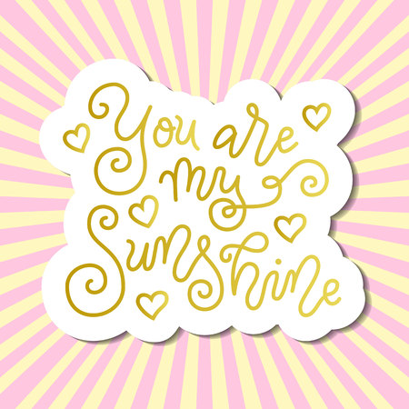 Modern calligraphy lettering of You are my sunshine in golden with white outline on background with pink rays for valentine, present, gift tag, flower shop, greeting card, poster, wedding, sticker Zdjęcie Seryjne - 122745450