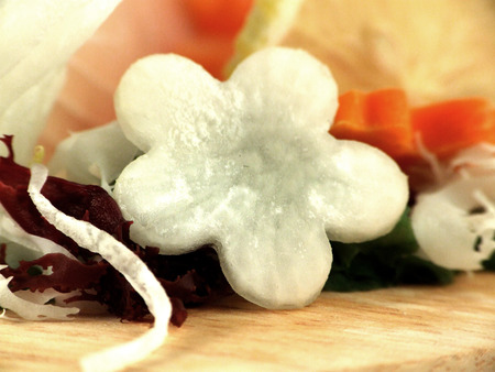 Beautiful daikon flower decorates salad and roll photo