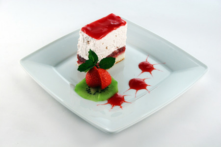 Delicious strawberry cheesecake with fresh strawberry, kiwi and topping photo