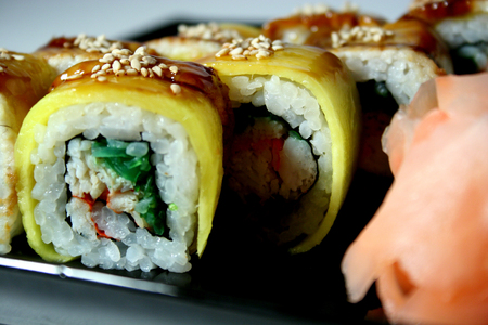 Asian food sushi roll with crab, chuka, avocado and sesam photo