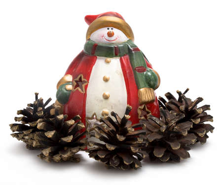 red snowman surrounded by spruce cones photo