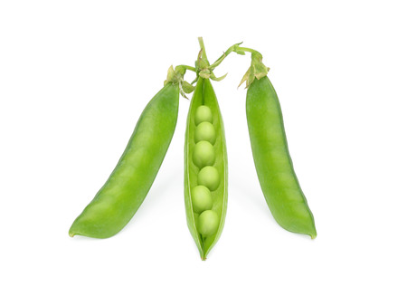 Green peas. Sweet green peas isolated on white. One pea pod is open.