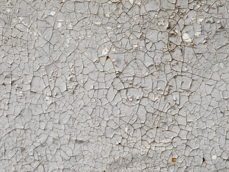 Texture of wood planks with cracked gray paint, abstract background.