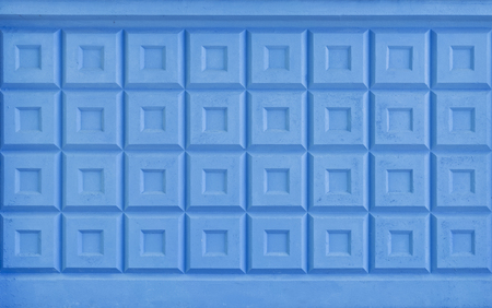 Texture of blue painted concrete fence.