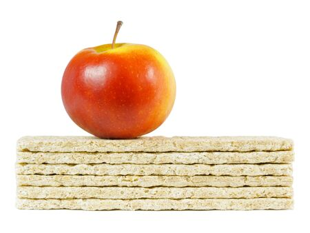 Stack of crispbread and red apple isolated on white background