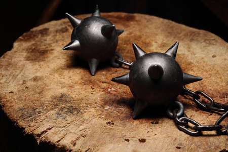 medieval blacksmith: This is a medieval weapon made in wood and iron. The result are two iron balls with spikes that are subjected with a stick.