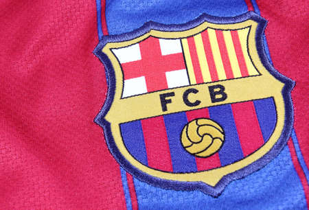 Barcelona, Spain - January 28, 2012: The crest of Barcelona Football Club on an official jersey. FC Barcelona were founded in 1899.