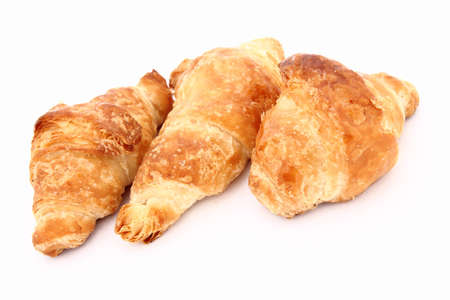 buttery: Is a buttery flaky pastry rolled and folded several times in succession, named laminating.  Stock Photo