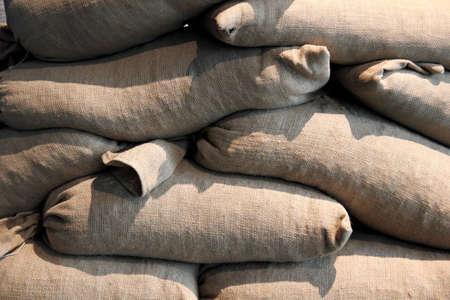 sandbag: A wall of sandbags for military protection