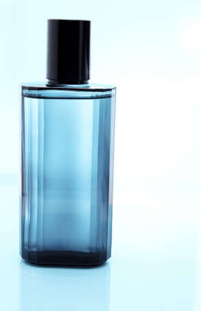 signle: Blue perfume bottle with reflection