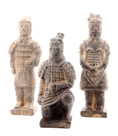 Ancient terracotta sculptures of Chinese warriors in Xian isolated on white. photo