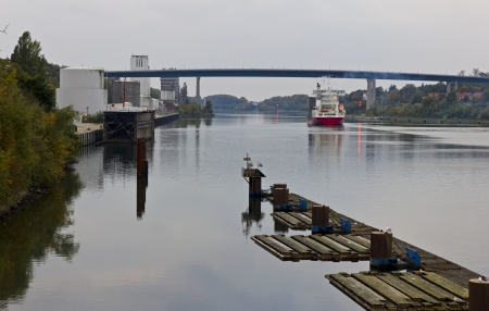 Nord-Ostsee-Kanal in kiel, germany. Kiel canal with lock of Holtenau in Germany. The KIEL-CANAL goes through the middle of Schleswig-Holstein. 98 km long from Brunsbüttel to Holtenau near Kiel.