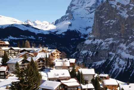 Alpine Village in winter day. Murren, Switzerland photo