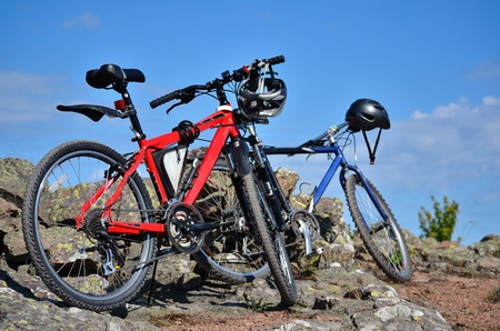 two mountain bikes standing in countryside photo