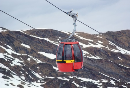 Red cable car in the Alps