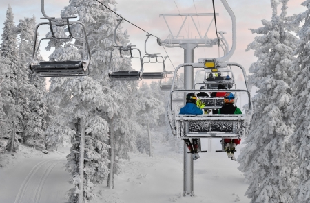 Ski chair lift with skiers  Ski resort in Ruka, Finland photo