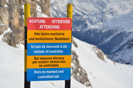 Warning informational sign on the ski slope in mountains- Here no marked and controlled trail,  St-Moritz, Switzerland Editorial