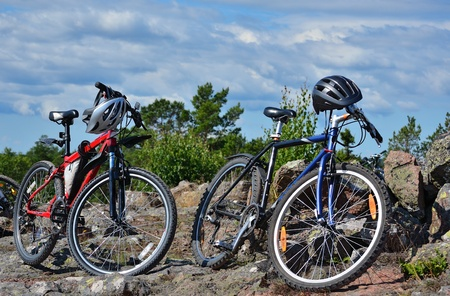 two mountain bikes standing in countryside