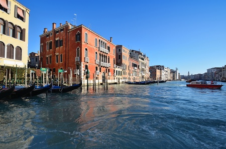 Embankment of the Grand canal in the rays of the morning sun  Venice, Italy