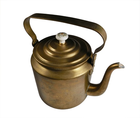 old brass kettle isolated on a white background