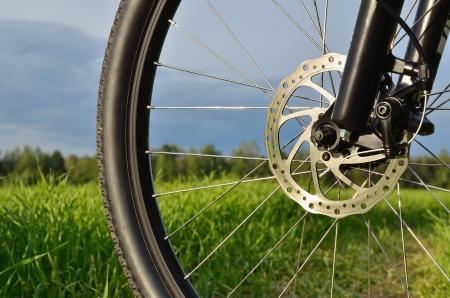 mountain bike wheel with disc brake, shallow depth of field Stock Photo - 13868484