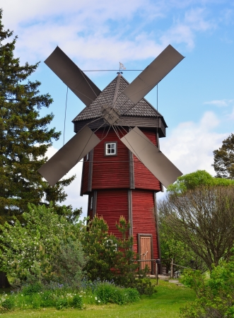 old wooden windmill in countryside photo