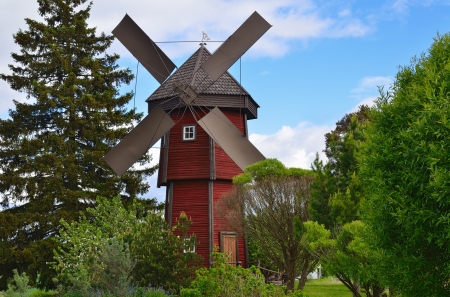 old wooden windmill in countryside