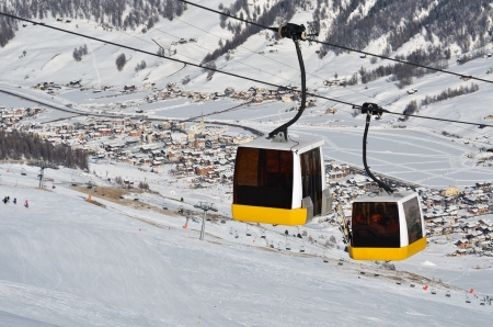 cable car in the skiing resort in Alps, Livigno, Italy Stock Photo