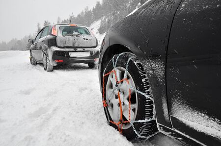Snow chains on the wheels of the car photo