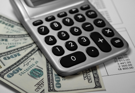 Calculator, money and paper with numbers, Shallow depth of field  Stock Photo