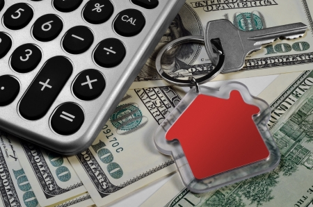 Calculator, money and house key, shallow depth of field  photo
