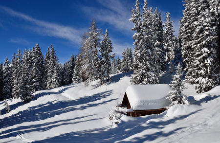 snow covered mountain: Winter landscape with small house in Austrian Alps Stock Photo