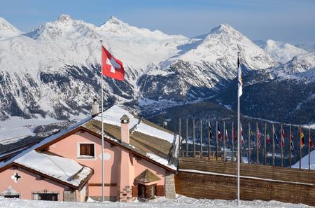 Building with swiss national flag on the alpine skiing resort. St. Moritz, Switzerland Reklamní fotografie