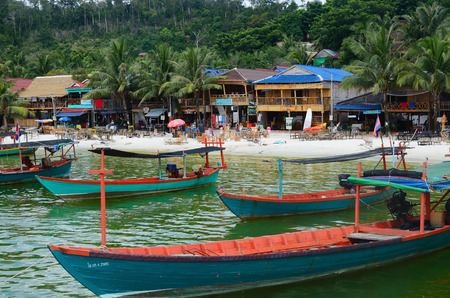 KOH RONG ISLAND, CAMBODIA - JULY 27, 2015: Village view with traditional khmer boats on the beach of Koh Rong Island near Sihanoukville, Gulf of Thailand, Cambodia