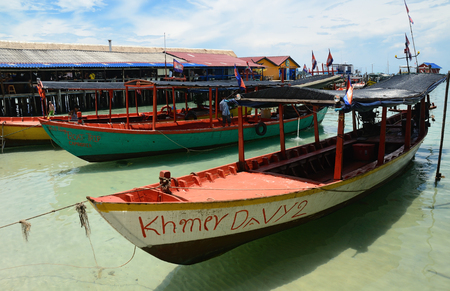 KOH RONG ISLAND, CAMBODIA - JULY 27, 2015: traditional khmer boats on the beach of Koh Rong Island near Sihanoukville, Gulf of Thailand, Cambodia