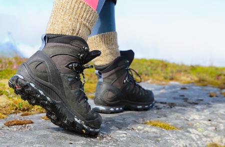 Hikers legs in trekking boots Reklamní fotografie