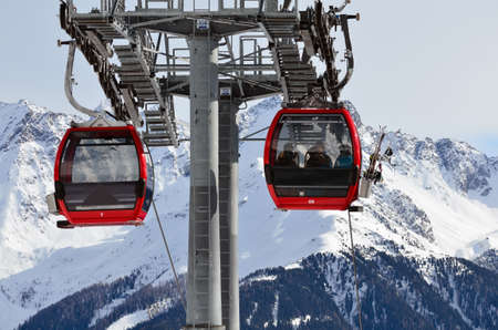 Red cable lift in the skiing resort in Alps Editorial